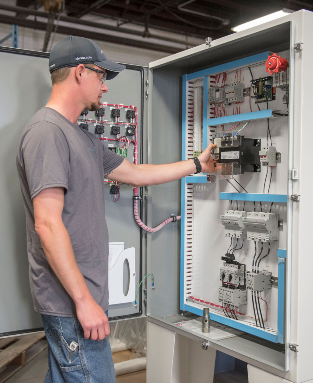 Employee working on electrical panel