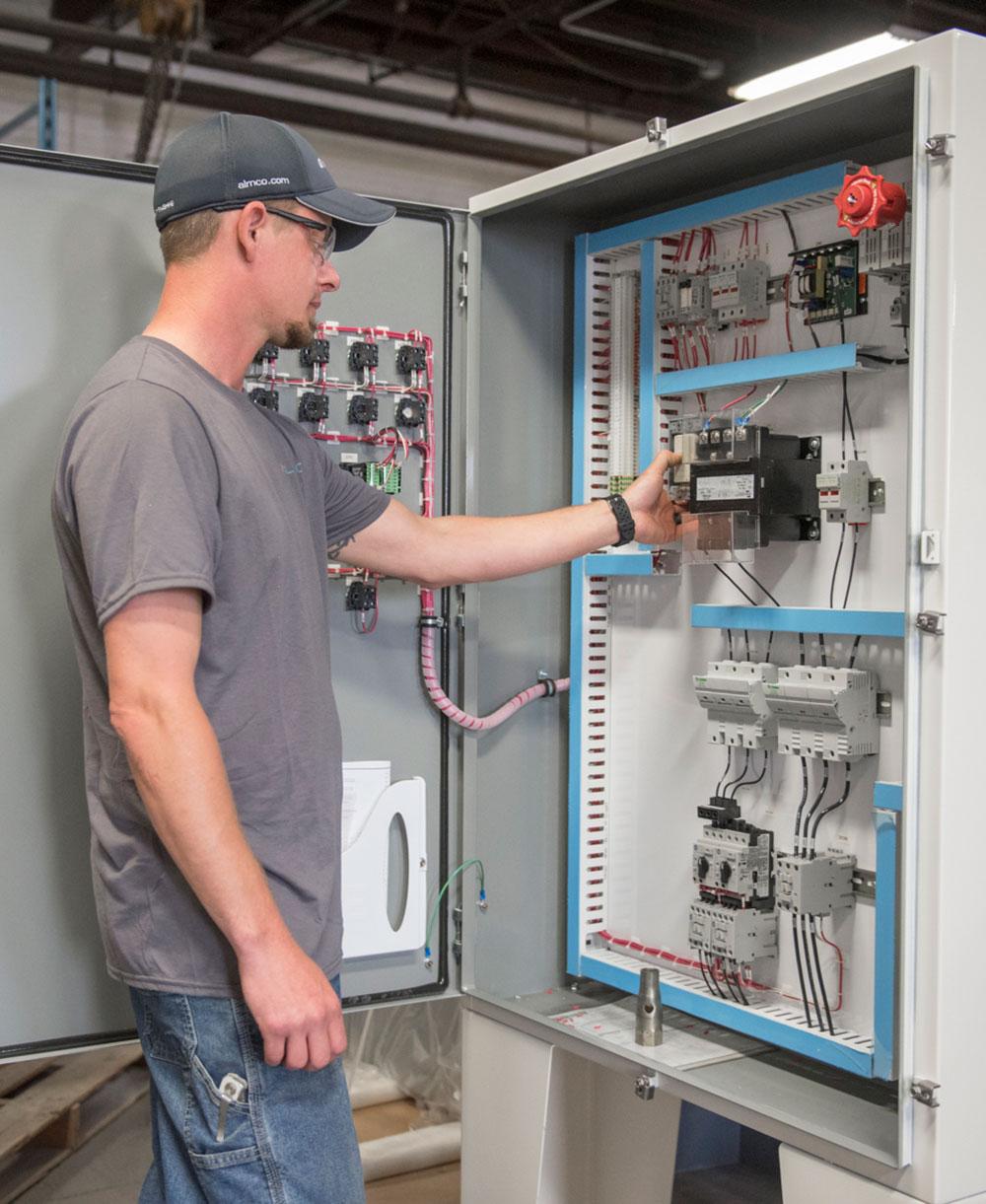 Employee working on electrical panel